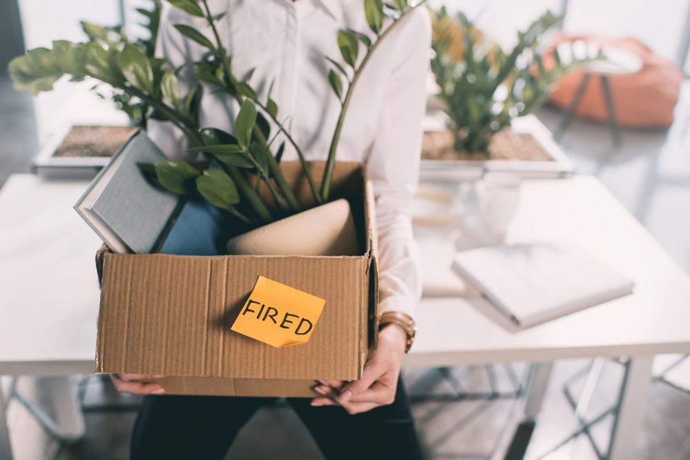 Fired employee with box of possessions