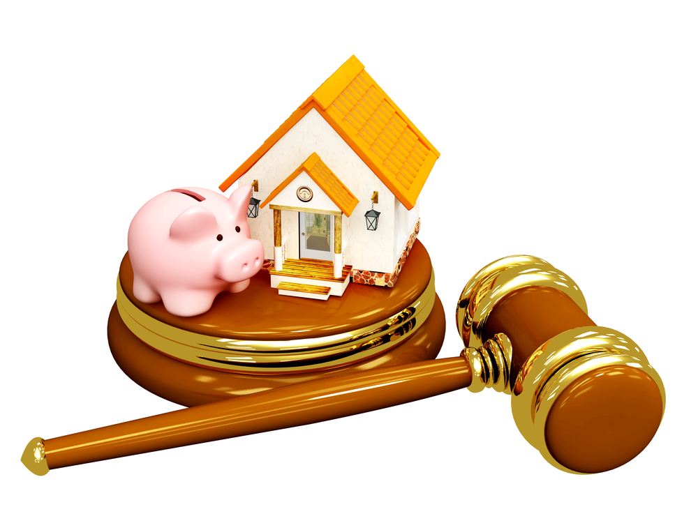Piggy bank and house with judge's gavel