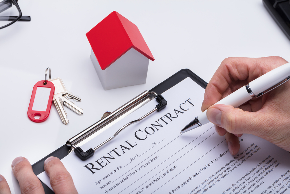hand signing rental contract