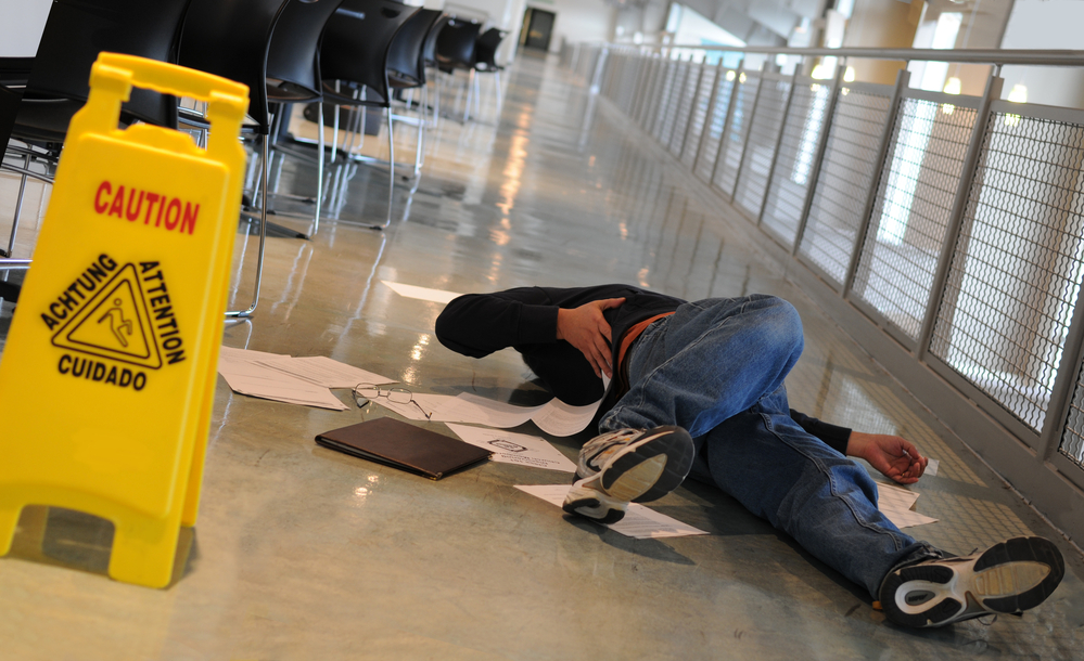 Fallen man near wet floor sign