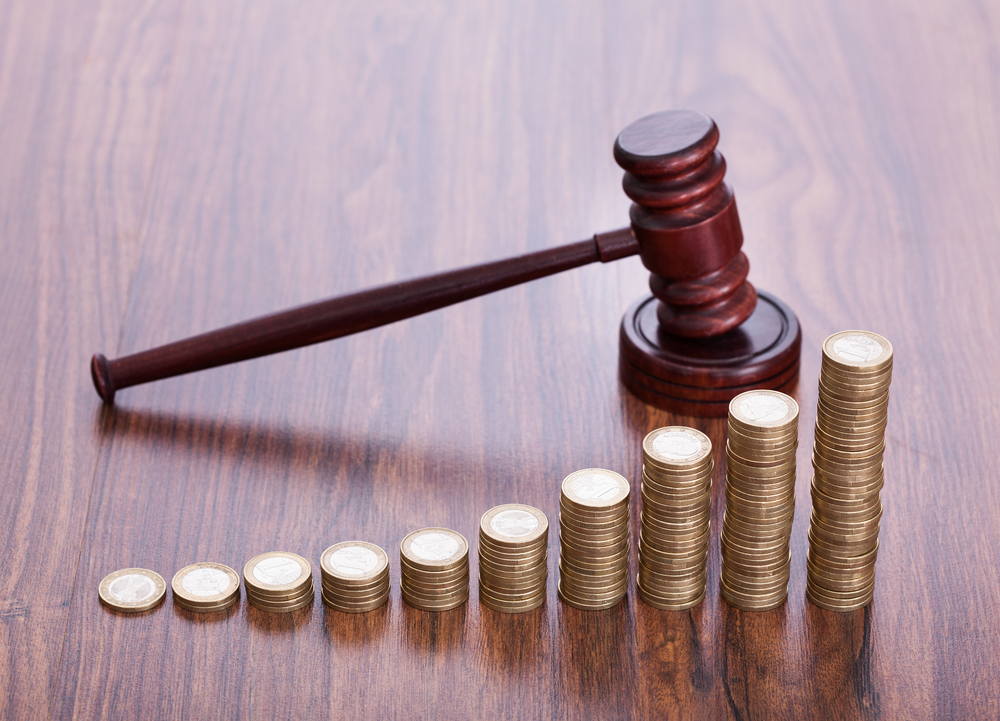 Coin stacks in front of gavel